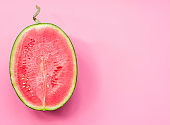 creative layout of fruit. a watermelon half on pink background
