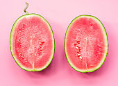 creative layout of fruit. a watermelon halves on pink background