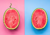 creative layout of fruit. a watermelon halves on pink and blue background