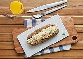 Whole wheat bread salad sandwich and orange juice