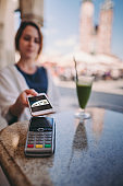 Woman traveling in Europe paying contactless with digital wallet