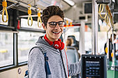 Smiling teenager went to school by bus