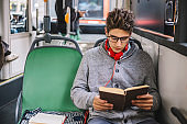 Student in a bus learning for exam