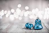 Three Blue Christmas Balls on White Rustic Wood Board
