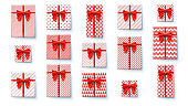 Set of present boxes, flat lay. Top view on wrapped in colored paper gift boxes with satin red bows. Vector concept of packages for Christmas, New Year, Happy birthdays, Weddings and Valentine Day.