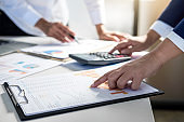 Teamwork of business colleagues consultation market growth on financial document graph report, professional occupation working analyzing startup and investment project to development grow to success