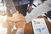 Business partnership meeting, Image of business people joining and putting hands together during their meeting, connection and collaboration concept, Teamwork process of partner and best relationship