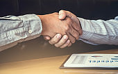 Meeting and greeting, Two executive businessman handshake after consultation and conference new business strategy plan, Trading contract and new projects for both companies, success, partnership