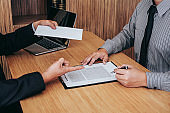 Hand of employer filing final remuneration after employee to write a document letter of resignation, resign concept