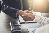 Meeting and greeting concept, Two confident Business handshake and business people after discussing good deal of Trading contract and new projects for both companies, success, partnership, co worker