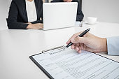 Employment and recruitment concept, Board reading a resume during a job interview and candidate sign contract for new colleagues in company, achievement approve