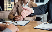 Welcome to colleagues, two senior manager shaking hands after during job interview, interview the job and hiring concept