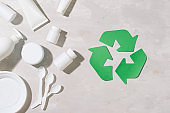 waste recycling eco symbol with garbage disposal on stone table background top view