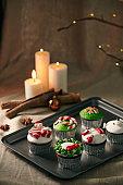 Christmas decoration on cupcakes, beautiful holiday background.