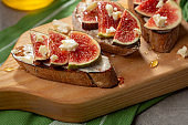 Figs and cheese canapes on board