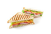 Sandwich with ham, cheese, tomatoes, lettuce, and toasted bread. Isolated on white background.