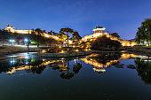 Reflection of Suwon Hwaseong fortres at night in Suwon.Korea