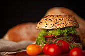 Delicious homemade hamburger with fresh vegetables in the kitchen