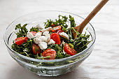 Caprese salad. Healthy meal with cherry tomatoes, mozzarella