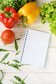bell pepper, green salad and notepad