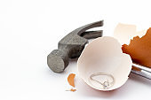 egg shell is broken by a hammer and fake diamond ring in the egg shell.