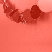 Hanging garland on orange background.
