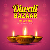 40-60% discount offer on Diwali Bazaar with illustration of illuminated oil lamps on shiny pink background for festival celebration concept.