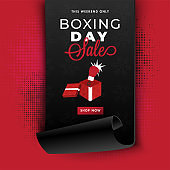 Curled paper style template or flyer design with surprise gift box and boxing glove on red halftone background for Boxing Day sale.