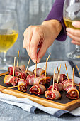 Dates wrapped with bacon