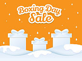 Sticker style text Boxing Day with gift boxes on winter landscape background for sale banner or poster design.