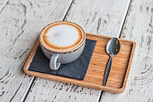Cup of coffee cappuccino latte art trendy cafe