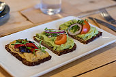 Avocado and hummus on crackers
