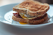 Homemade Breakfast Egg Sandwich with Cheese and bacon on Toast