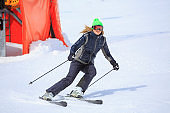 Woman skier skiing  Ski resort  Amateur Winter Sports. High mountain snowy landscape.  Kronplatz, mountain of the Dolomites in South Tyrol, Italy.