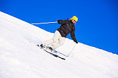 Amateur Winter Sports woman skier skiing at sunny  ski resort Dolomites in Italy