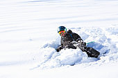 Man skier skiing  lying down in powder snow. Skiing accident Falling  Back country skiing,  at ski resort Dolomites in Italy.