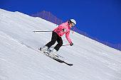 Amateur Winter Sports Girl skier skiing at  ski resort Dolomites in Italy