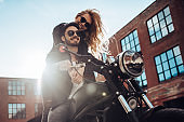 couple with motorcycle