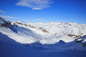 High mountain sunset landscape with ski lift. At the top. Italian Alps ski area. Passo Tonale. italy, Europe