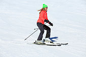 Woman skier skiing at sunny ski resort Amateur Winter Sports
