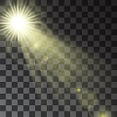 Glowing vector golden spotlight effect, star beams, projector rays with sun shining warm halo. Decorative glittering dust. Sun flare and hotspot design details on transparent background.