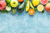 top view of different selected juicy organic tropical fruits, superfood, healthy meal concept, healthy food background