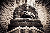 The Stone Buddha statue at the Wat Phra Kaew Palace, also known as the Emerald Buddha Temple. Bangkok, Thailand.