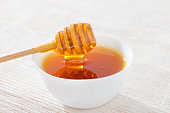 honey on white wooden table