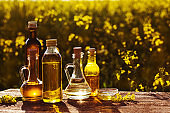 rapeseed oil on wooden table in field