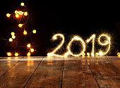 Sparkler Happy New Year 2019 With Defocused Lights On Wooden Floor
