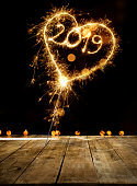 Sparkler Heart With New Year 2019 On Wooden Floor