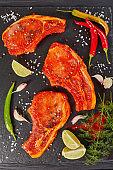 raw pork chops prepared to cook