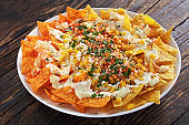 close-up of nachos with cheese and corn