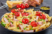 salad with pasta penne, ham, peas